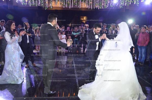 حمادة هلال وتامر عاشور والليثي وبوسي نجوم زفاف «عبدالله وحياة»