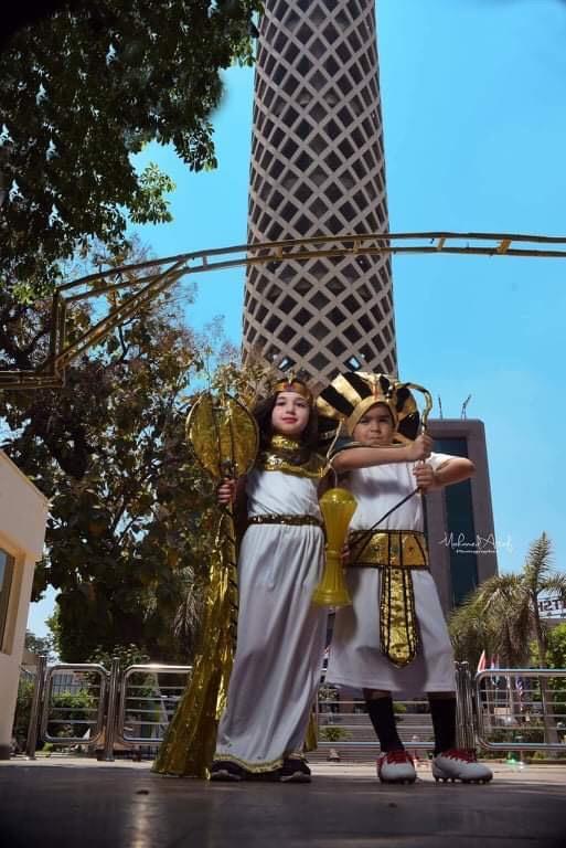 جلسة تصوير أطفال متلازمة داون وهم يشجعون منتخب مصر