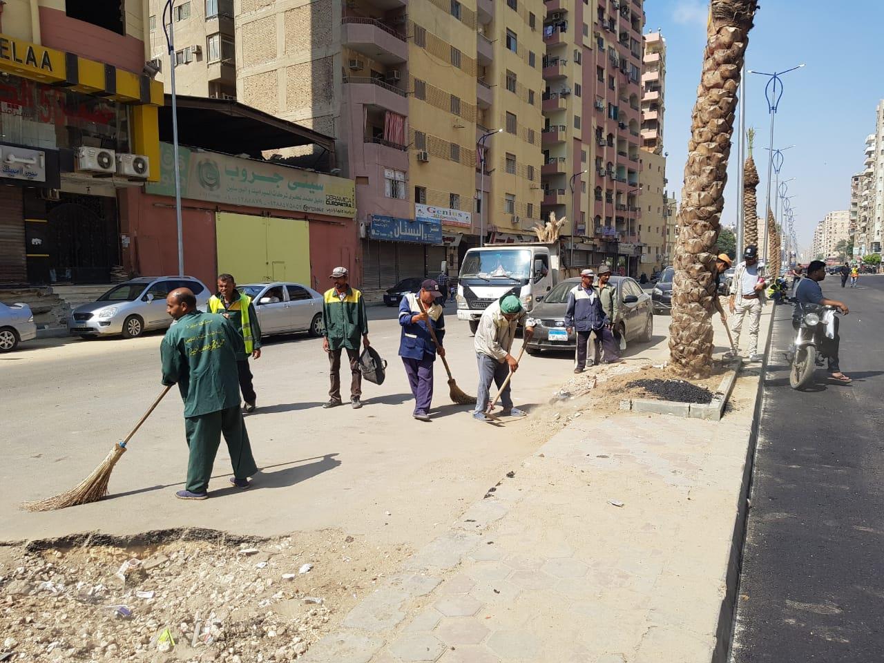 حملة نظافة وتجميل شارع الزعيم السادات في الطالبية بالجيزة