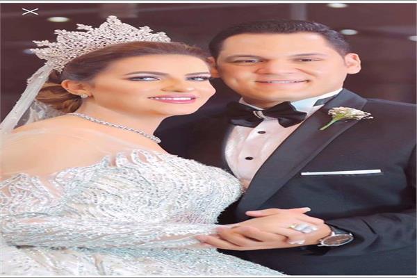 المستشار احمد شكرى وزوجته