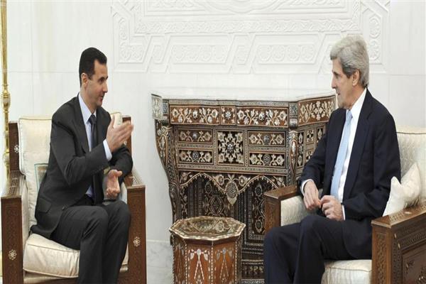 جون كيري وبشار الأسد