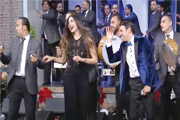 سعد الصغير والمذيعة دينا صلاح فى احتفالات العام الجديد