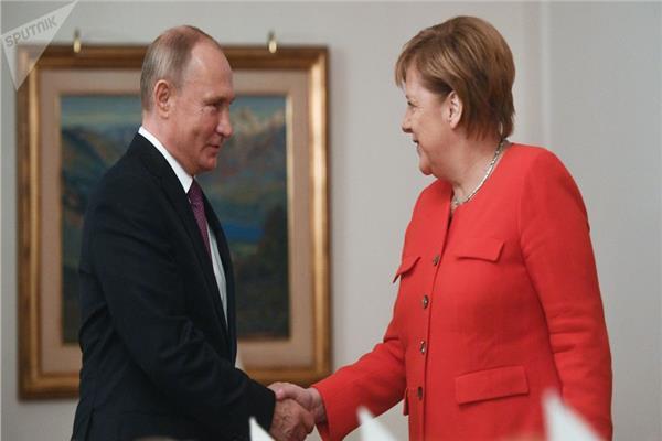 الرئيس الروسي فلاديمير بوتين و المستشارة الألمانية أنجيلا ميركل