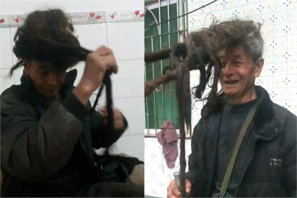 بالصور.. صيني لم يقص شعره منذ 54 عاماً خوفا على احفاده