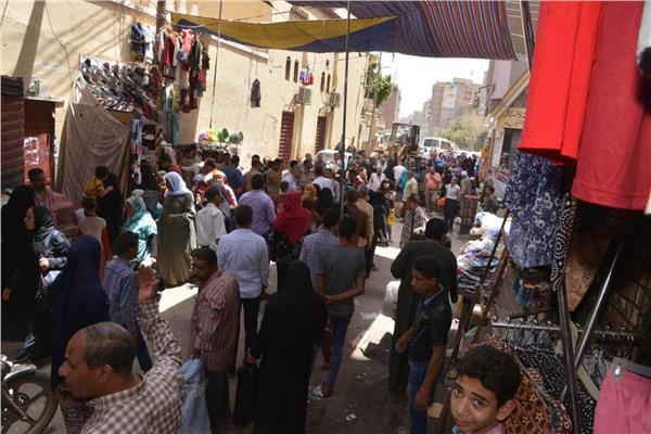 حملة على شارع بورسعيد القيسارية بمحافظة أسيوط