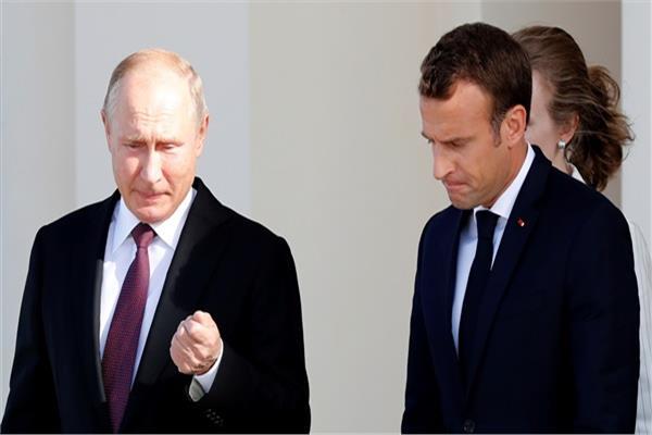 إيمانويل ماكرون وفلاديمير بوتين