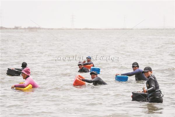 الصيادون فى بحيرة المنزلة
