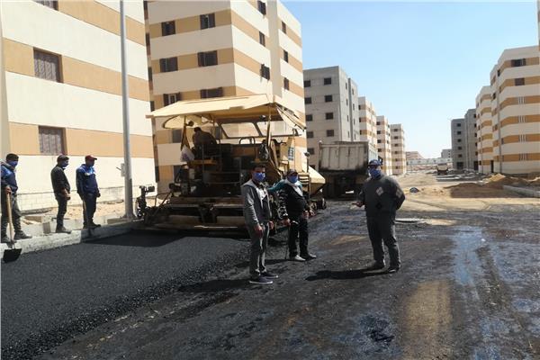 رصف طرق عمارات الإسكان الاجتماعي بمدينة العبور الجديدة