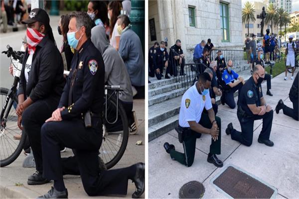 ركوع الشرطة الأمريكية على ركبتهم