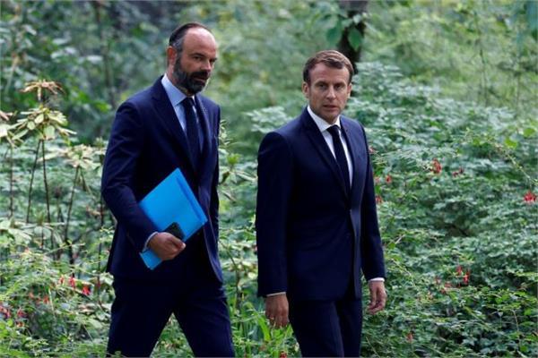 الرئيس الفرنسي ايمانويل ماكرون و رئيس الوزراء إدوارد فيليب - رويترز