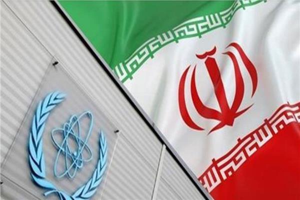 علم إيران وشعار الوكالة