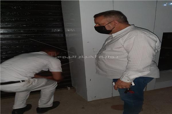 غلق وتشميع محل ملابس في الطالبية بالجيزة  صور