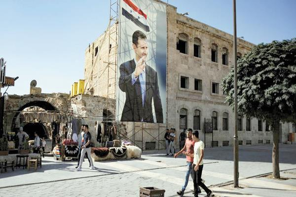 لافتات التأييد لإعادة انتخابات بشار الأسد على كل مبانى المدن السورية