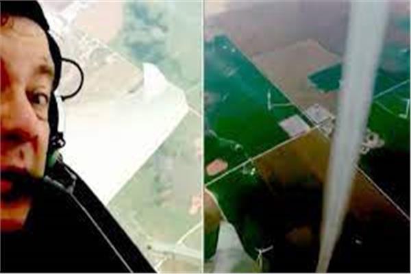 طيار يصور فيديو لإعصار حلق بجانب طائرته