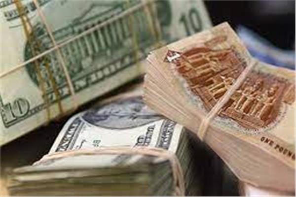 الدولار والجنيه- أرشيفية