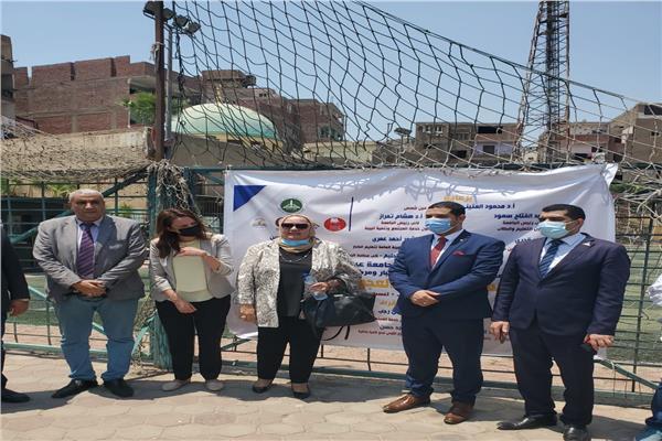 تجارة جامعة عين شمس تنظم قافلةلمحو الأمية بحي العجوزة