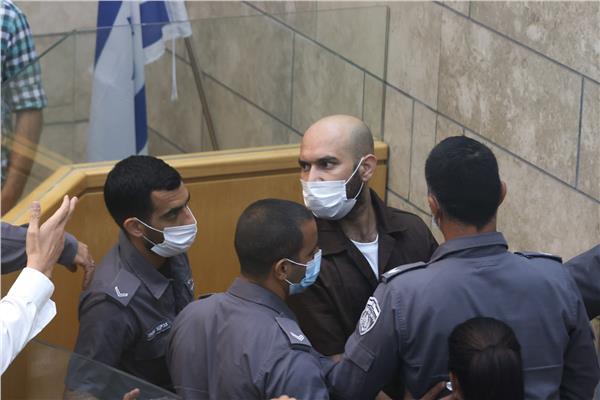 أيهم كمامجي في المحكمة بعد اعتقاله