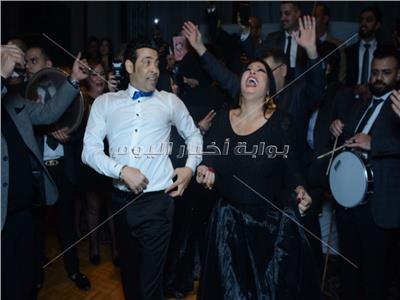 صور| كوكبة فنية بزفاف «أحمد وألحان».. الصغير وفيفي عبده وأوكسانا نجوم الحفل
