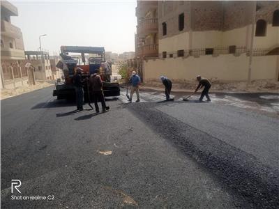 تنفيذ أعمالرصف طرق حي النوادي بمدينة المنيا الجديدة