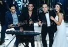 صور| الهضبة وآلا كوشنير يُشعلان زفاف تامر عبدالمنعم بحضور مشاهير الفن