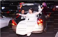 لقطة اليوم| زفة عروسين في «شنطة عربية»