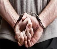 ضبط تاجر مخدرات هارب من حكم مؤبد في الوراق