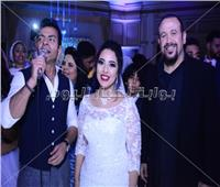 صور| هشام عباس ومحي وفارس يحتفلون بزفاف «أحمد وحنين»