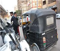 ضبط 25 سيارة نقل جماعي بالجيزة لعدم التزامهم بالتعريفات المقررة