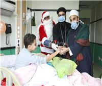 صور| رجال الأزهر والكنيسة يهنئون أطفال ٥٧٣٥٧ بعيد الميلاد