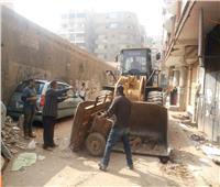صور| إزالة الحواجز الحديدية في مدينة السلام