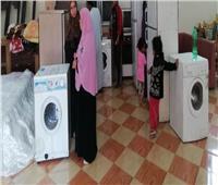 صور| الأورمان تنظم معرضًا لتوزيع الملابس والأجهزة الكهربائية بالمجان في البحيرة