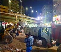 صور.. حملة مكبرة بحي العمرانية لإزالة إشغالات شارع عثمان محرم