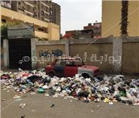 صور| قبل العيد.. أحياء بالقاهرة تحارب قمامة الشوارع الرئيسية وتبقي «الجانبية»
