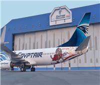صوروفيديو| مصر للطيران تزين أكبر طائرات أسطولها الجوي بشعار «الكان»