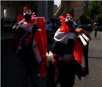 بالصور| محمد صلاح وعلم مصر في قلب وعقل مشجعي «أمم أفريقيا 2019»