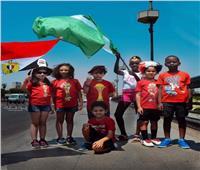 صور| أطفال «متلازمة داون» يشجعون منتخب مصر