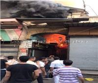 بالصور.. السيطرة على حريق ضخم في سوق الخضار بالعتبة