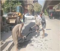 ترميم شوارع شمال الجيزة من الحفر لمنع وقوع حوادث السيارات