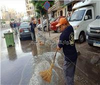 صور| الأجهزة التنفيذية بالإسكندرية تواصل إزالة أثار مياه الأمطار