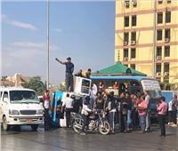 صور  انقلاب سيارة ميكروباص محملة بالركاب بالجيزة