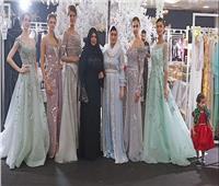منى المنصوري تعرض فستان زفاف وسهرة وأثواب عربية وقفاطين مغربية.. صور