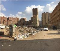 صور| «الطوابق فيصل غرقانة في الزبالة».. والأهالي: «يرضي مين العيشة دي»