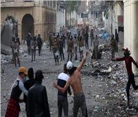 إصابة 25 متظاهرا وشرطيا في مواجهات بينهما بمدينة الكوت العراقية