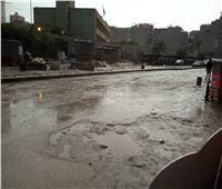 صور  منخفض التنين.. سيول وبرق ورعد تضرب محافظة الجيزة
