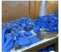 صور.. الداخلية ضبط 42 ألف كمامة داخل مصنع بدون ترخيص