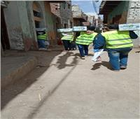 الأورمان توزع مواد غذائية وإعانات نقدية للأسر المتضررة في سوهاج