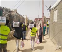توزيعمساعدات على 100 أسرة بقرية أبو المطامير