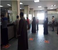 صور| لمنع الزحام.. مكاتب البريد بالأقصر تنفذ تعليمات الصحة للوقاية من كورنا
