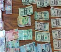 ضبط 4 تجار عملة بحوزتهم مليوني جنيه وعملات أجنبية مختلفة