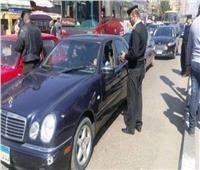الحكومة توضح حقيقة فرض عقوبة على عدم ارتداء «الكمامة» بالسيارات الخاصة
